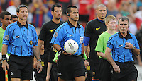 Referees entering the field. Manchester United defeated Barcelona FC 2-1 at FedEx Field in Landover, MD Saturday July 30, 2011.