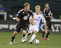 Danny Allsopp #9 of D.C. United pushes the ball away from Brad Ring #5 of the San Jose Earthquakes during an MLS match at RFK Stadium in Washington D.C. on October 9 2010. San Jose won 2-0.