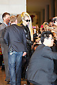 """Lady Gaga, wearing a black leather coat, sunglasses, high heels and her rainbow-colored hair, is greeted by Japanese fans upon her arrival at Narita Airport, Tokyo, on Tuesday, May 8, 2012. .Lady Gaga is in Japan on a """"Lady Gaga/The Born This Way Ball"""" world tour and will play four nights in an arena venue just outside of Tokyo."""