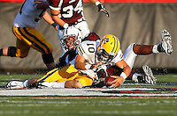 Michael Strizak #34 of Don Bosco sacks Joe Greco #10 of St Ignatius during the game at Harding Stadium in Steubenville, OH on September 25, 2010. ..Jared Wickerham.