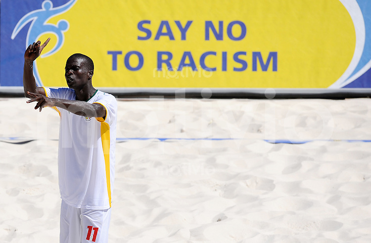 FIFA BEACH SOCCER WORLD CUP 2008 SENEGAL - URUGUAY   19.07.2008 Gomis MBENGUE (SEN) gestures in front of a 'SAY NO TO RACISM' board.