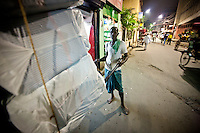 The rickshaw puller works as long as the businesses are open and their are goods to deliver.