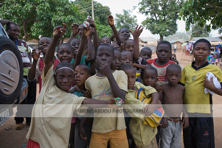 Children in the Durumi area of Abuja, Nigeria clown around for the camera.