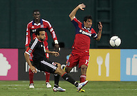 WASHINGTON, DC. - AUGUST 22, 2012:  Dwayne DeRosario (7) of DC United makes a pass past  Pavel Pardo (17) of the Chicago Fire during an MLS match at RFK Stadium, in Washington DC,  on August 22. United won 4-2.