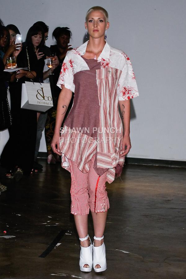 Models wear clothing from the Neodandi Spring Summer 2013 fashion show by Niilartey De Osu, during New York Fashion Week, September 13, 2012.