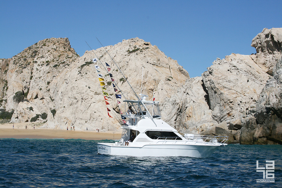 Sport fishing yacht at Divorce beach in Cabo San Lucas