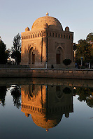 Mausoleum of the Samanids, 9th-10th century, Bukhara, Uzbekistan, pictured on July 11, 2010 reflected in a pool by the late afternoon light. Built of kiln-dried bricks by Ismail Samani for his father Nasr I, who died in 892, the harmony of its geometrical form has earned it a place on the register of World Heritage. Bukhara, a city on the Silk Route is about 2500 years old. Its long history is displayed both through the impressive monuments and the overall town planning and architecture.