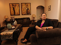 NWA Democrat-Gazette/ANDY SHUPE<br /> Danielle Wood of Fayetteville enjoys spending time in the living room of her Fayetteville home. Friday, April 8, 2016.