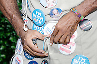 A man sells pro-Clinton campaign buttons to people waiting to enter a campaign rally for Democratic presidential nominee Hillary Clinton in the Theodore R. Gibson Health Center at Miami Dade College-Kendall Campus in Miami, Florida, USA. Former Vice President Al Gore also spoke at the rally.