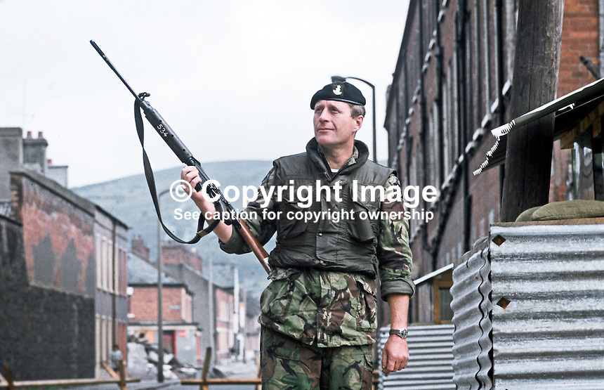 Soldier with rifle on duty outside observation post, Crumlin Road, Belfast, N Ireland, September, 1971, 197109000431m <br /> <br /> Copyright Image from Victor Patterson,<br /> 54 Dorchester Park, Belfast, UK, BT9 6RJ<br /> <br /> t1: +44 28 90661296<br /> t2: +44 28 90022446<br /> m: +44 7802 353836<br /> <br /> e1: victorpatterson@me.com<br /> e2: victorpatterson@gmail.com<br /> <br /> For my Terms and Conditions of Use go to<br /> www.victorpatterson.com