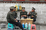 Chinese military take a tea break in the Barkhor, Lhasa, Tibet. 8/6/05.