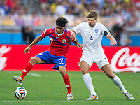 Christian Bolanos of Costa Rica and Steven Gerrard of England