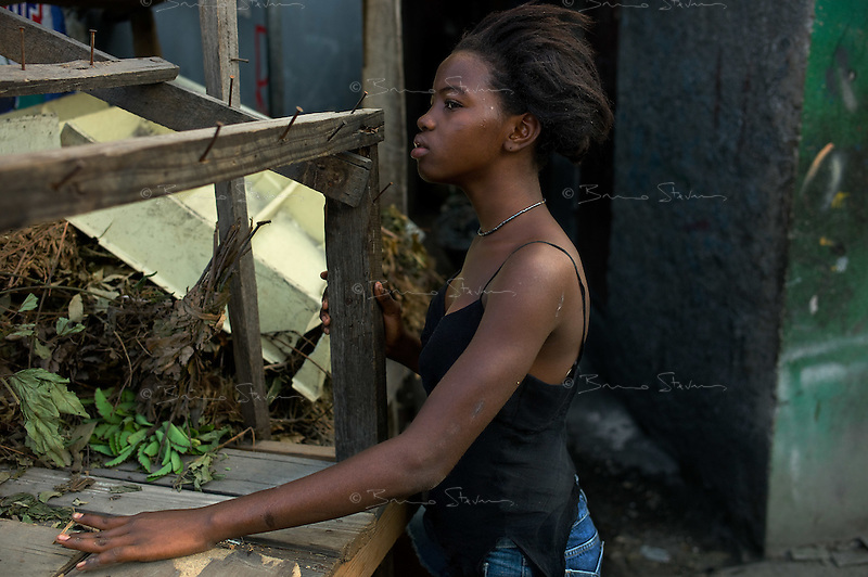 Port au Prince, Haiti, April 21, 2010.Fredline, 14, lost her mother in the earthquake and is now living with 'friends'. The area around the old 'Salomon' market is one of the poorest in the city and still mostly in ruins, 3 months after the earthquake.