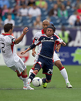 New England Revolution midfielder Lee Nguyen (24) attempts to control the ball as DC United defender Robbie Russell (3) defends. In a Major League Soccer (MLS) match, DC United defeated the New England Revolution, 2-1, at Gillette Stadium on April 14, 2012.