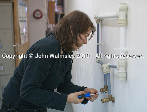 Plumbing student preparing some plumbing to an exact specification, Able Skills, Dartford, Kent.