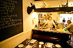 """Old Montreal restaurant classics in the heart of Little Burgundy. An homage to Charles """"Joe-Beef"""" McKiernan, 19th century innkeeper and Montreal working class hero. A drunken crawl away from the Historic Atwater market featuring steaks and seafood."""