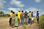 Children watching a United Methodist mission airplane come in for a landing.