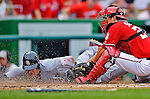2 September 2012: Washington Nationals' catcher Kurt Suzuki tags a sliding Allen Craig out at home on a throw from rookie outfielder Bryce Harper during a game against the St. Louis Cardinals at Nationals Park in Washington, DC. The Nationals edged out the visiting Cardinals 4-3, capping their 4-game series with three wins. Mandatory Credit: Ed Wolfstein Photo