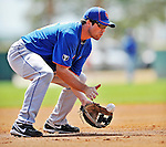 10 March 2012: New York Mets catcher Vinny Rottino takes infield drills prior to a Spring Training game against the Washington Nationals at Space Coast Stadium in Viera, Florida. The Nationals defeated the Mets 8-2 in Grapefruit League play. Mandatory Credit: Ed Wolfstein Photo