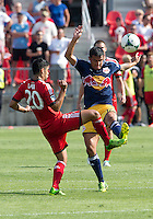 20 July 2013: Toronto FC midfielder Matias Laba #20 battles with New York Red Bulls midfielder Tim Cahill #17 during an MLS regular season game between the New York Red Bulls and Toronto FC at BMO Field in Toronto, Ontario Canada.<br /> The game ended in a 0-0 draw.