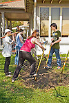 Students of high school and college groups dig with shovels for water prevention and drainage project around house in New Orleans,Louisiana