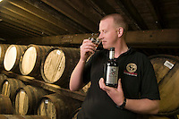 Isle of Islay, Hebrides, Scotland, May 2010. Andrew  Brown, master distiller. The Bunnahabhain Distillery is located on the sound of Islay. Dutch Tallship Thalassa sails between the islands along the Scotish west coast in search of the quality single malt whisky that is produced by the many distilleries. Photo by Frits Meyst/Adventure4ever.com
