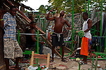 Bordered by collapsed buildings in Jacmel, young men work out in a street gym. The 7.0 earthquake that devastated parts of Haiti on January 12 killed hundreds of thousands of people. January's earthquake killed hundreds of thousands of people and caused significant and lasting structural and economic damage in the Caribbean nation.