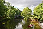 Woman kayaking the Blackstone River in Uxbridge