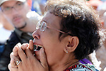 """A woman weeps outside a Phnom Penh court on December 14, 2012, after hearing that judges denied an appeal by Mam Sonando, a Cambodian radio journalist and human rights activist, who in October 2012 was sentenced to 20 years in prison for """"insurrection,"""" despite international calls for his release."""