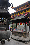 Ornate Incense burning cauldrons outside Buddhist temple in Guilin, China