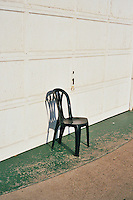 A green plastic chair sits outside a building on the Minnesota State Fair grounds during the off season