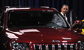 United States President Barack Obama looks at a Jeep during a visit to the DC Auto Show at the Walter E. Washington Convention Center in Washington, DC on January 31, 2012. .Credit: Olivier Douliery / Pool via CNP