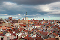 View across the rooftops of the old town of Perpignan, with the cathedral or Basilique-Cathedrale de Saint-Jean-Baptiste de Perpignan, built 1324-15th century in Catalan Gothic style, Perpignan, Languedoc-Roussillon, France. Picture by Manuel Cohen