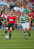 July 16, 2010 Darren Fletcher No. 24 of Manchester United and Scott Brown No. 8 of Celtic FC during an international friendly between Manchester United and Celtic FC at the Rogers Centre in Toronto.