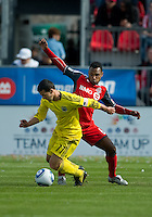 23 April 2011: Columbus Crew midfielder Dilly Duka #11and Toronto FC midfielder Julian de Guzman #6 in action during a game between the Columbus Crew and the Toronto FC at BMO Field in Toronto, Ontario Canada..The game ended in a 1-1 draw.