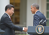 United States President Barack Obama, right, and President XI Jinping of China, left, shake hands after conducting a joint press conference in the Rose Garden of the White House in Washington, DC on Friday, September 25, 2015.<br /> Credit: Ron Sachs / CNP