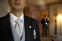 Switzerland. Canton Graubünden. St. Moritz. Hotel Carlton. Butlers. Matheus Alcover (L). Gilles Ungright (R) head butler. Hotel suite. Matheus Alcover wears a Matrix tie's knot.  © 2008 Didier Ruef
