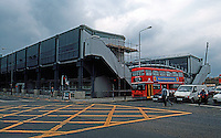Nicholas Grimshaw: Sainsbury's Camden Town, 3/4, showing cantilever and stacking of offices over Camden Road Front.  Photo '90.