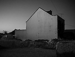 The blank end of a house at night