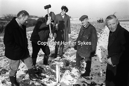 Laxton Jury Day and Court Leet. Laxton, Nottinghamshire. England 1973. Staking out the strips of land. Annually November and first week of December.<br /> <br /> Laxton is the only place in England where the open-field system continues to be used.  It is thought that its anomalous survival is due to the inability of two early 19th century landowners to agree on how the land was to be enclosed, thus resulting in the perpetuation of the existing system.<br /> <br />  My ref 24/669/1973,