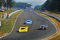 The Dyson Racing Porsche 962 driven by James Weaver leads a group of cars during the 1991 IMSA race at Watkins Glen, New York, USA.