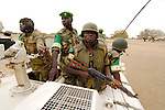 African Union troops from Nigeria on patrol in the town of Labado, which was attacked by government military forces and Arab militias in December 2004, causing the town's 25,000 people to flee for their lives.