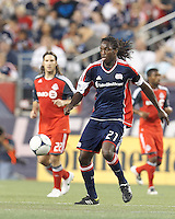 New England Revolution substitute midfielder Shalrie Joseph (21) at midfield. In a Major League Soccer (MLS) match, Toronto FC defeated New England Revolution, 1-0, at Gillette Stadium on July 14, 2012.