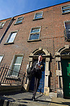 """Editorial Use Only. Bloomsday June  16th 2008, Dublin. Actor Paul O'Hanrahan from Balloonatics theatre company performs the """"Calypso"""" chapter from  James Joyce novel Ulysses around Eccles St. and Dorset Street. In this photo, Bloom kicks open the """"jakes"""" or toilet door."""