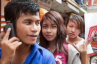 December 31st, 2008_Phnom Penh, Cambodia_ Three young kids sit on a motorbike in Phnom Penh around the area of the famous Central Market, which is a well know landmark in the capital city.   Photographer: Daniel J. Groshong/Tayo Photo Group