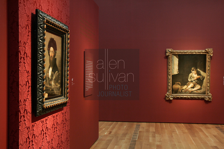 """Portrait of Baldassare Castiglione"" by Raphael (left) and ""The Young Beggar"" by Bertolomé Esteban Murillo at the Anne Cox Chambers Wing of the High Museum of Art. Over the next three years, the High Museum will feature hundreds of works of art from the Musée de Louvre."
