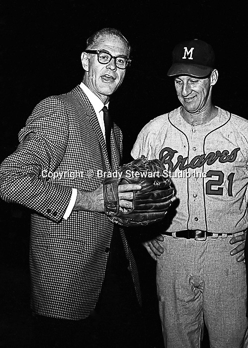 """Pittsburgh PA:  Warren Spahn talking with Pittsburgh Pirate announcer, Bob """"the Gunner"""" Prince at the HYPO charity baseball game with the Milwaukee Braves - 1965. The money raised by HYPO (Help Young Players Organize) was used to help local communities buy equipment and build ball fields"""