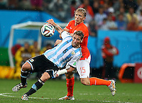 Lucas Biglia of Argentina and Dirk Kuyt of Netherlands in action