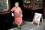 English woman out side her shop Brick Lane  Whitechapel East London 1970s. Sign in both English and Asian.