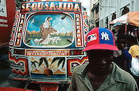 """Haiti. Province of Ouest. Port-Au-Prince. Downtown. Market area. Densely populated area.  Public transport """"Tap Tap"""". Collective taxis. © 2003 Didier Ruef"""